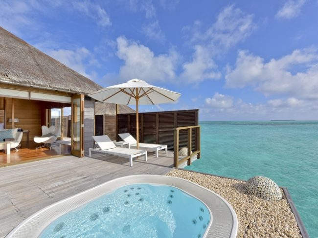 Outdoor jacuzzi on overwater villa
