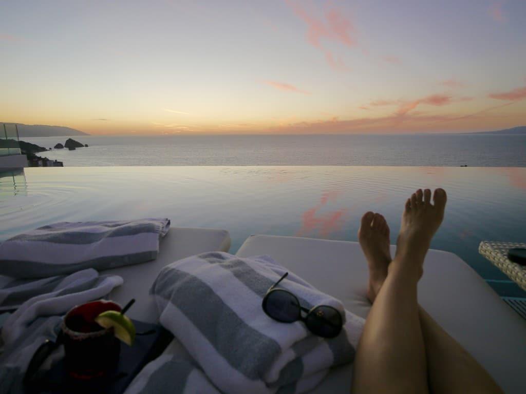 Garza Blanca Mousai pool sunset