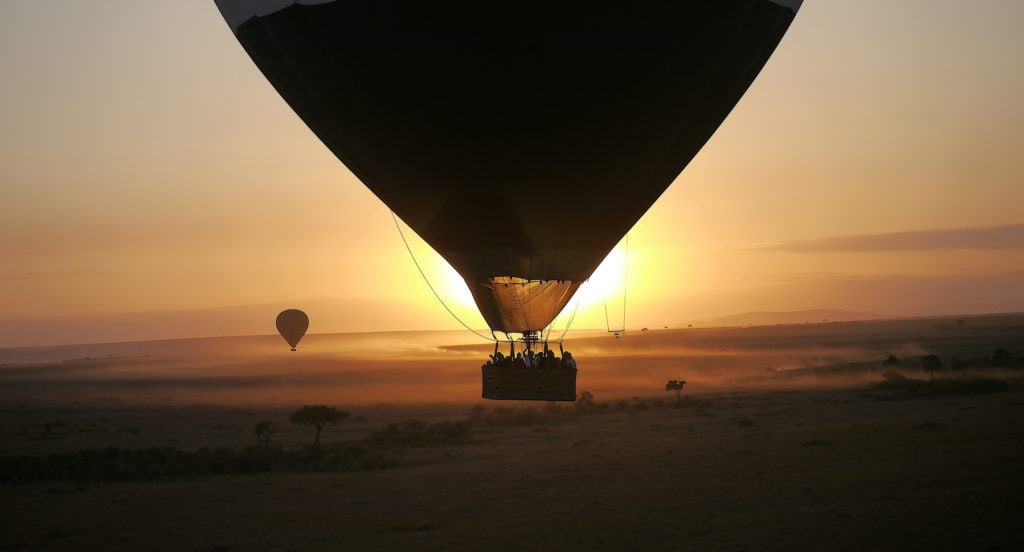 Hot air balloon against the sunrise at Maasai Mara