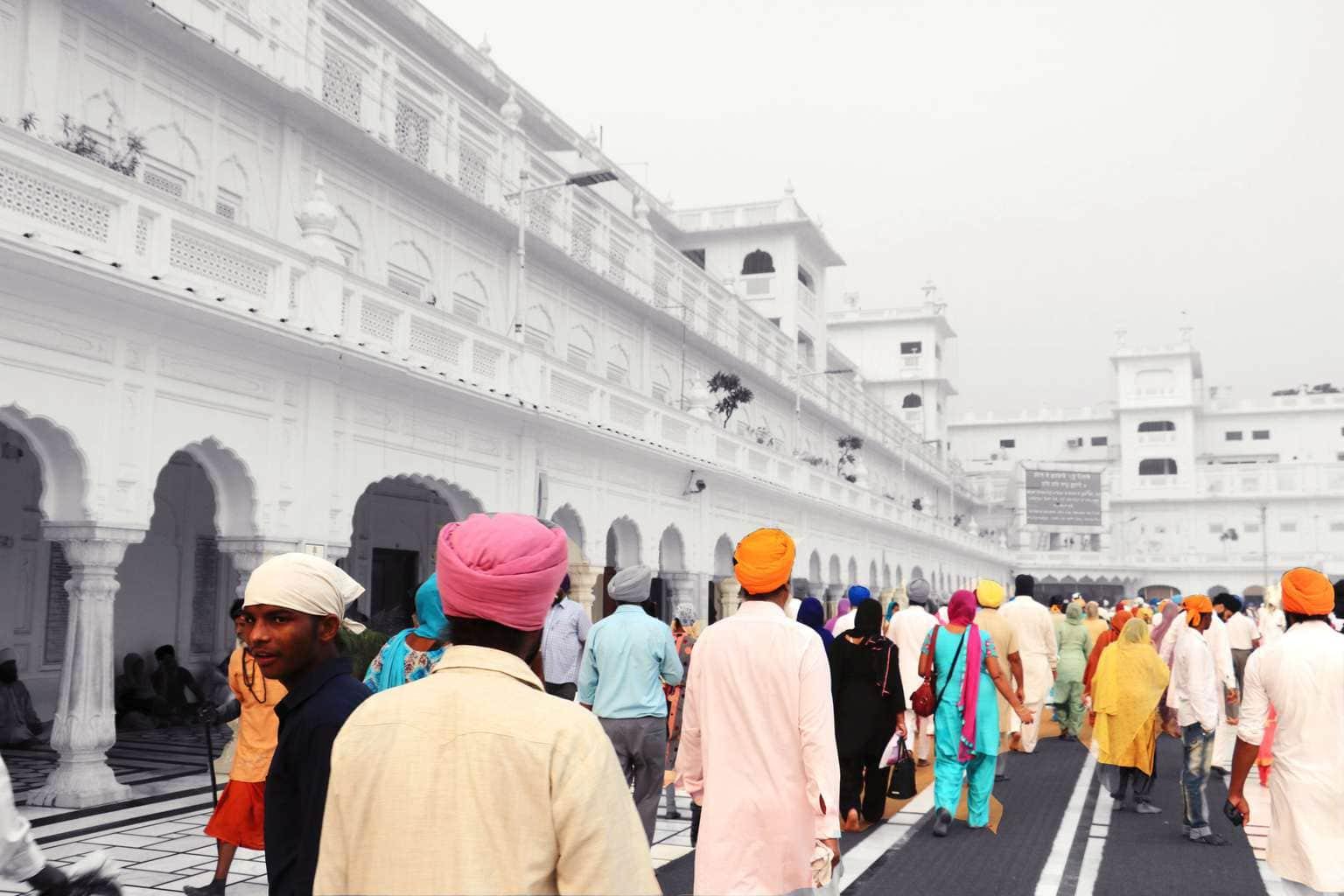 Devotees walking around The Golden Temple Amritsar