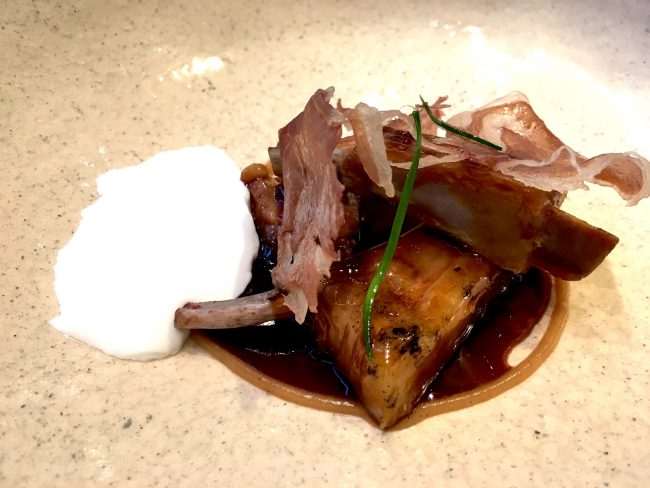 Roasted, cured and dried suckling lamb meats with garlic compote, pine shoots and caramelized jus at ABaC