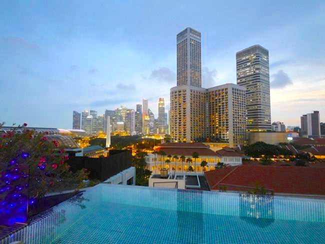 Naumi infinity rooftop pool at sunset