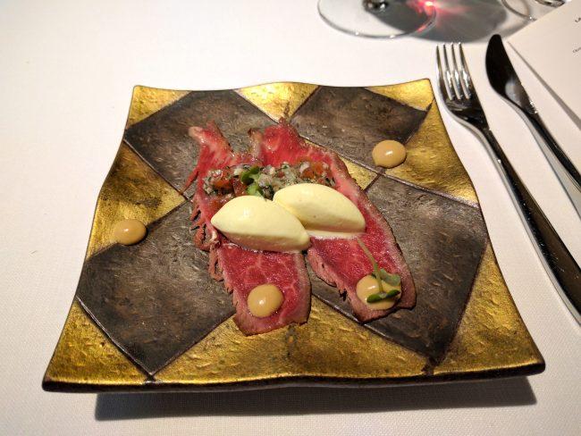 Slices of Iberian presa on foie-gras curd