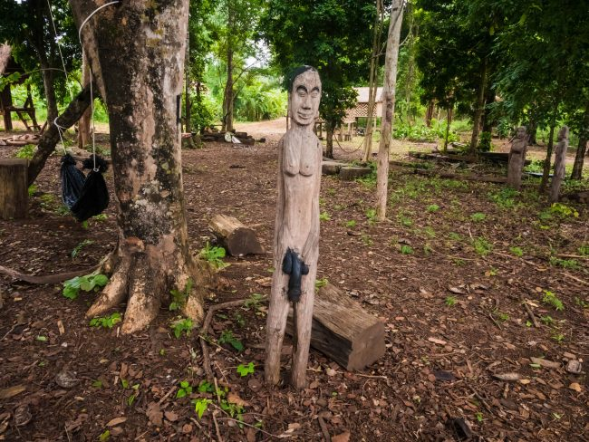 Statue by the huts