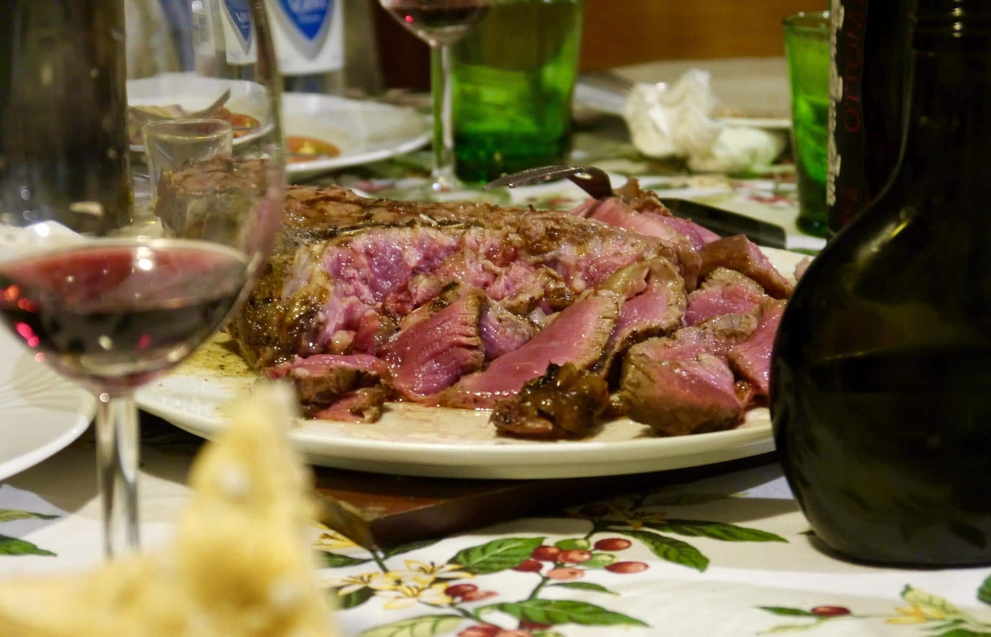A Florentine steak with a glass of Brunello di Montalcino enjoyed at an Italian home