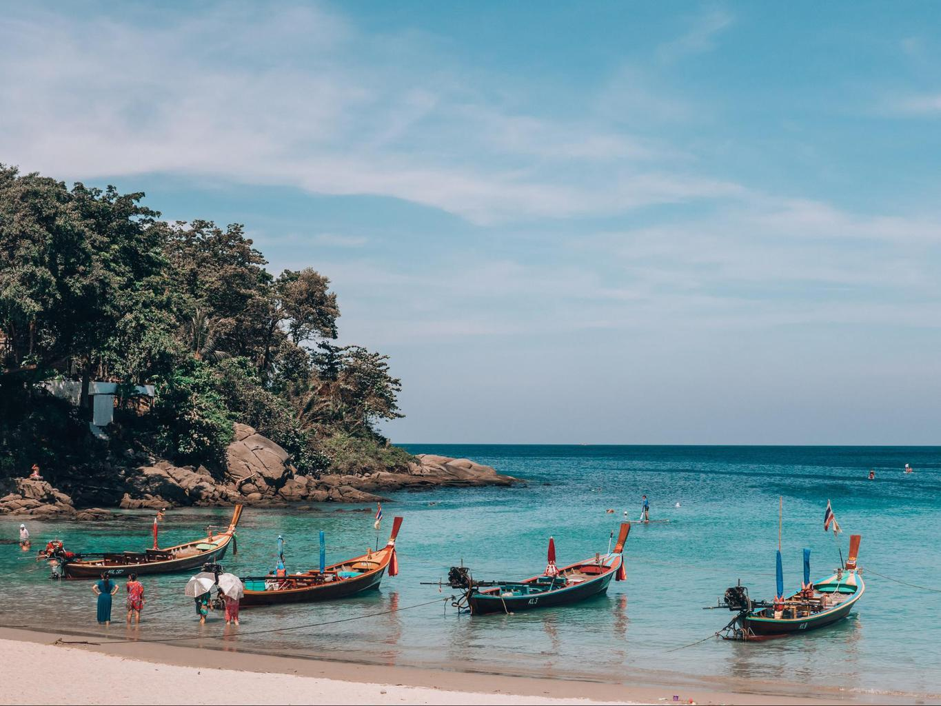 Longtail boats in Kata beach ready to take you to an island
