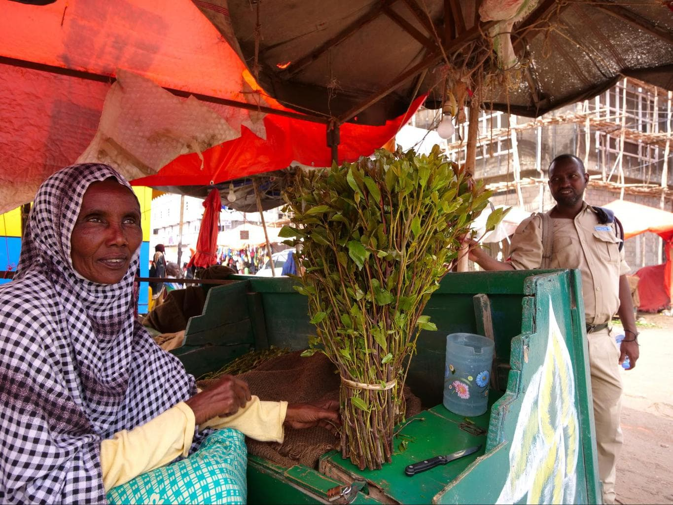 Our Somaliland SPU police escort chatting to a khat seller in Hargeisa