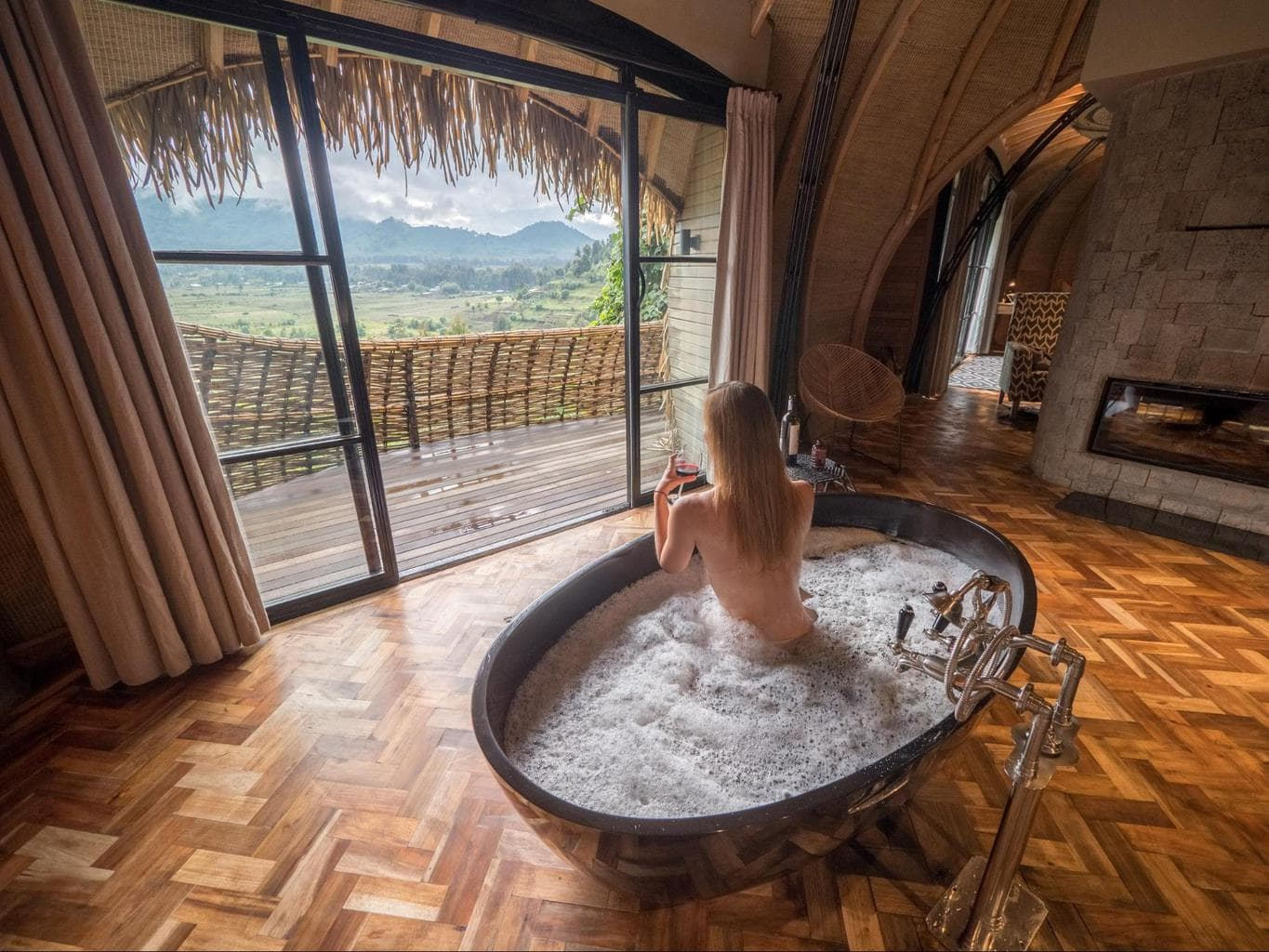 Soaking in the hot bathtub with a glass of wine while it's cold outside at Bisate Lodge
