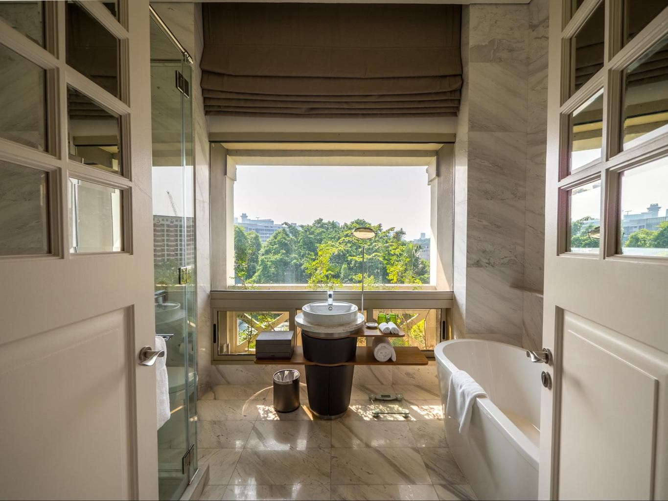 The glass enclosed verandah bathrooms at Hotel Fort Canning