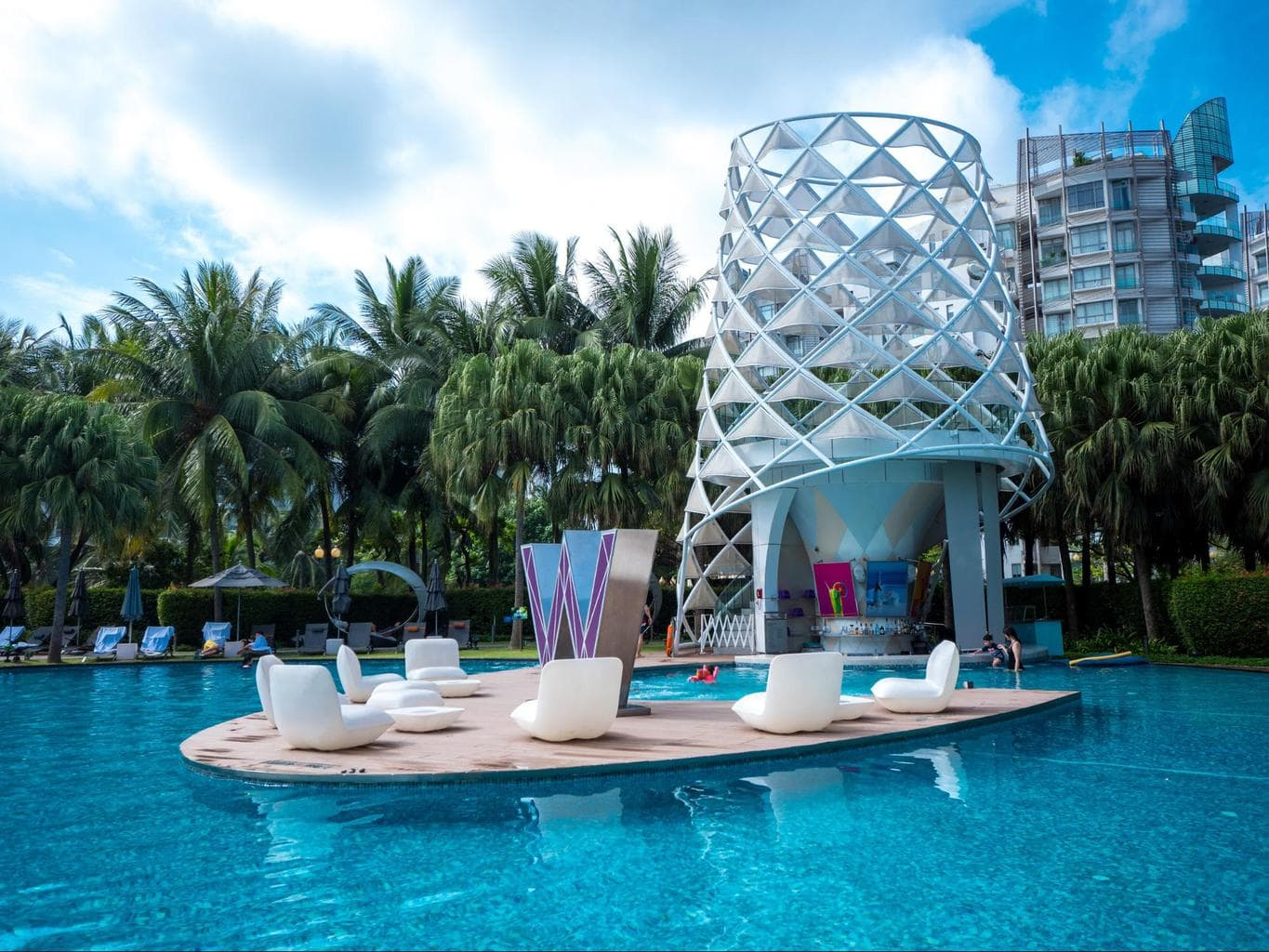 The pool area and swim up bar at the W Singapore - Sentosa Cove