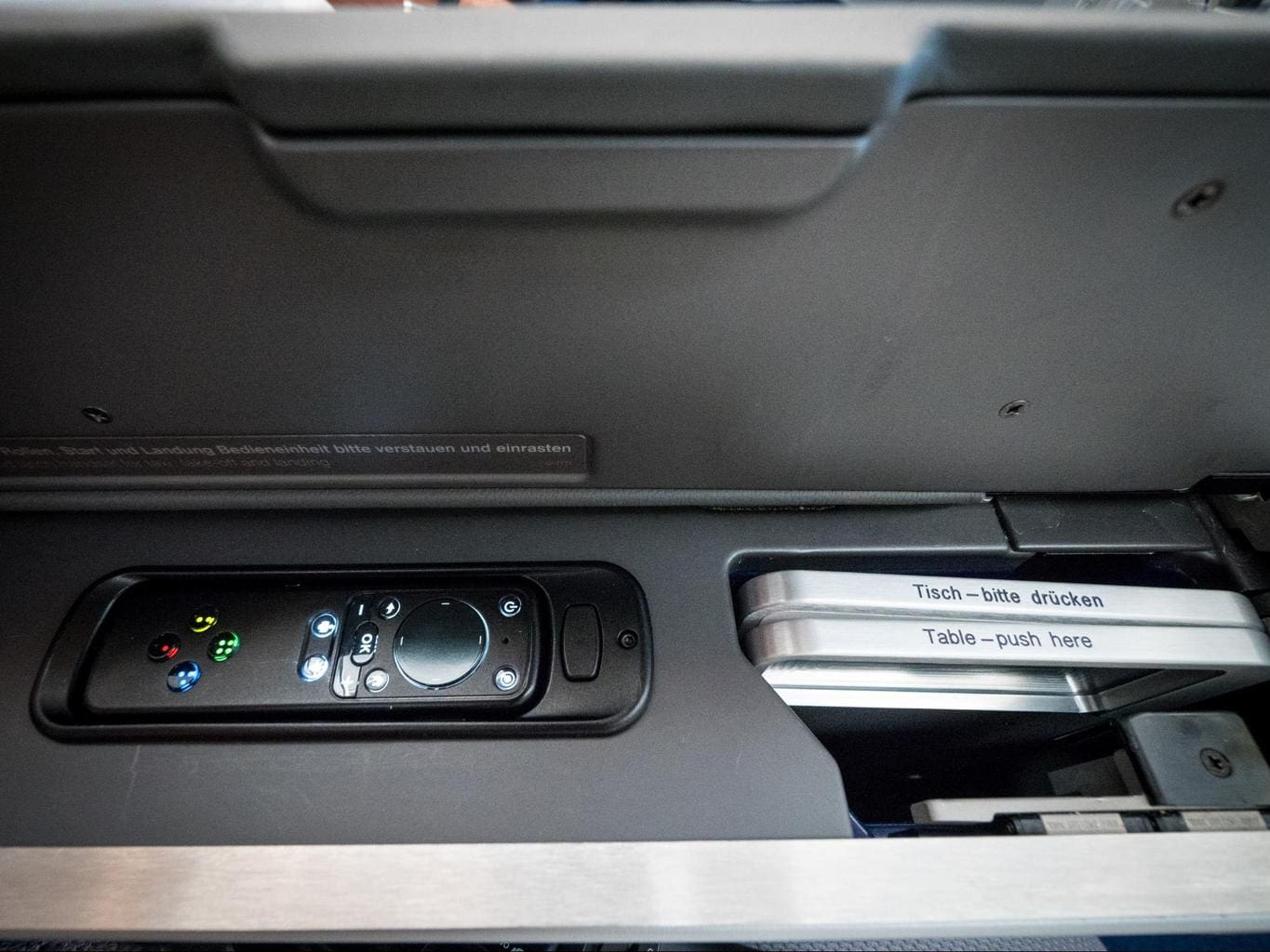 The entertainment system remote control and pull-out table