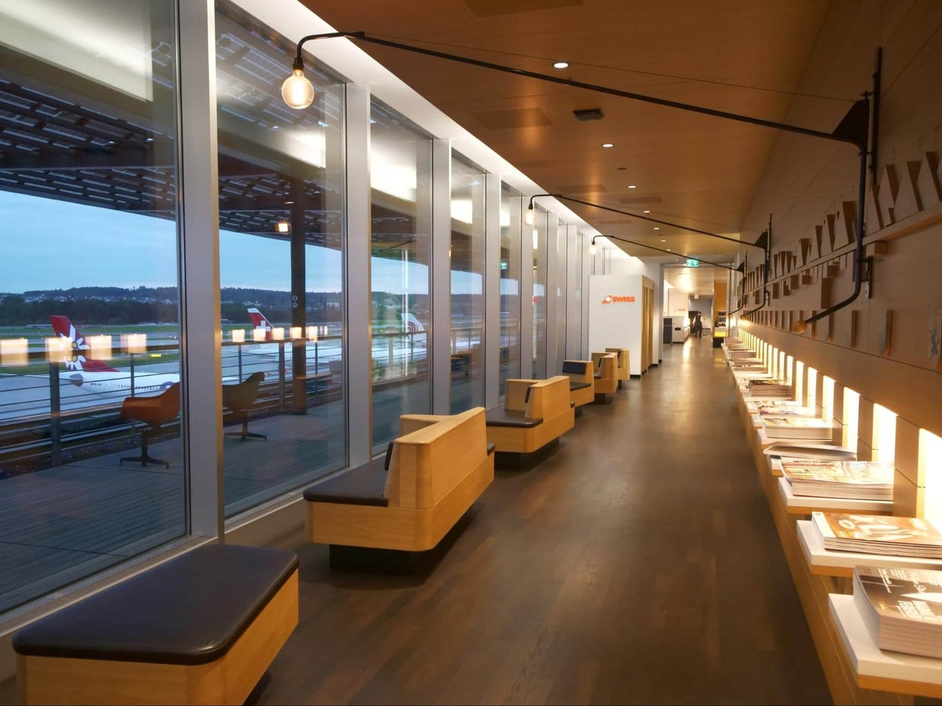 Entrance of Swiss Senator Lounge at Zurich airport with runway views