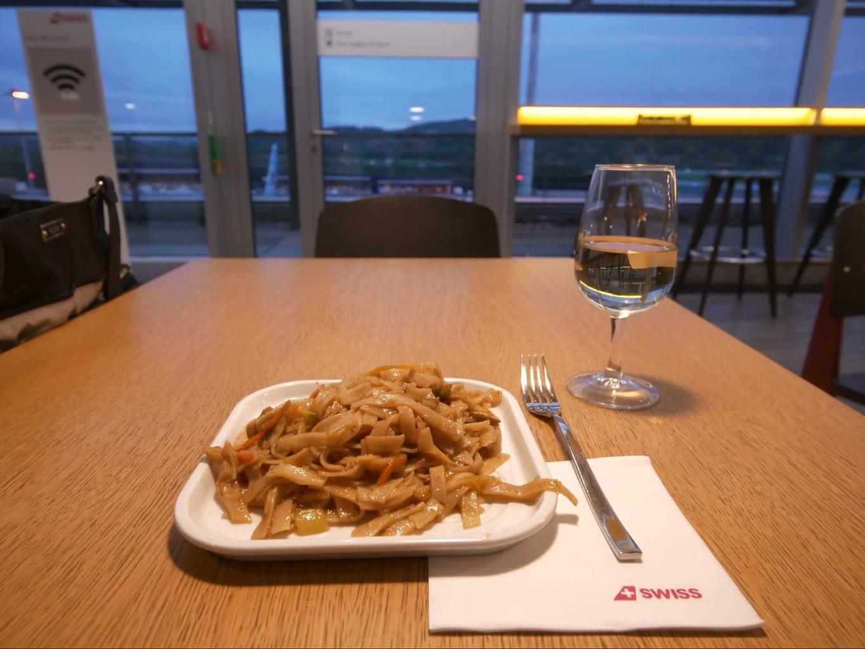 Warm dish from the live station at Swiss Senator Lounge