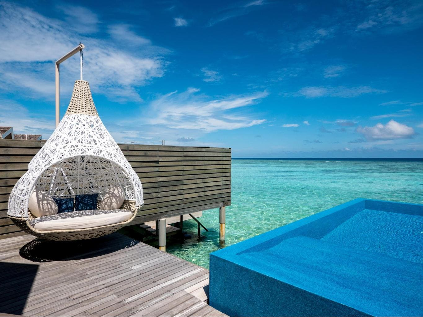 Outdoor deck of the romantic pool water villa at LUX*