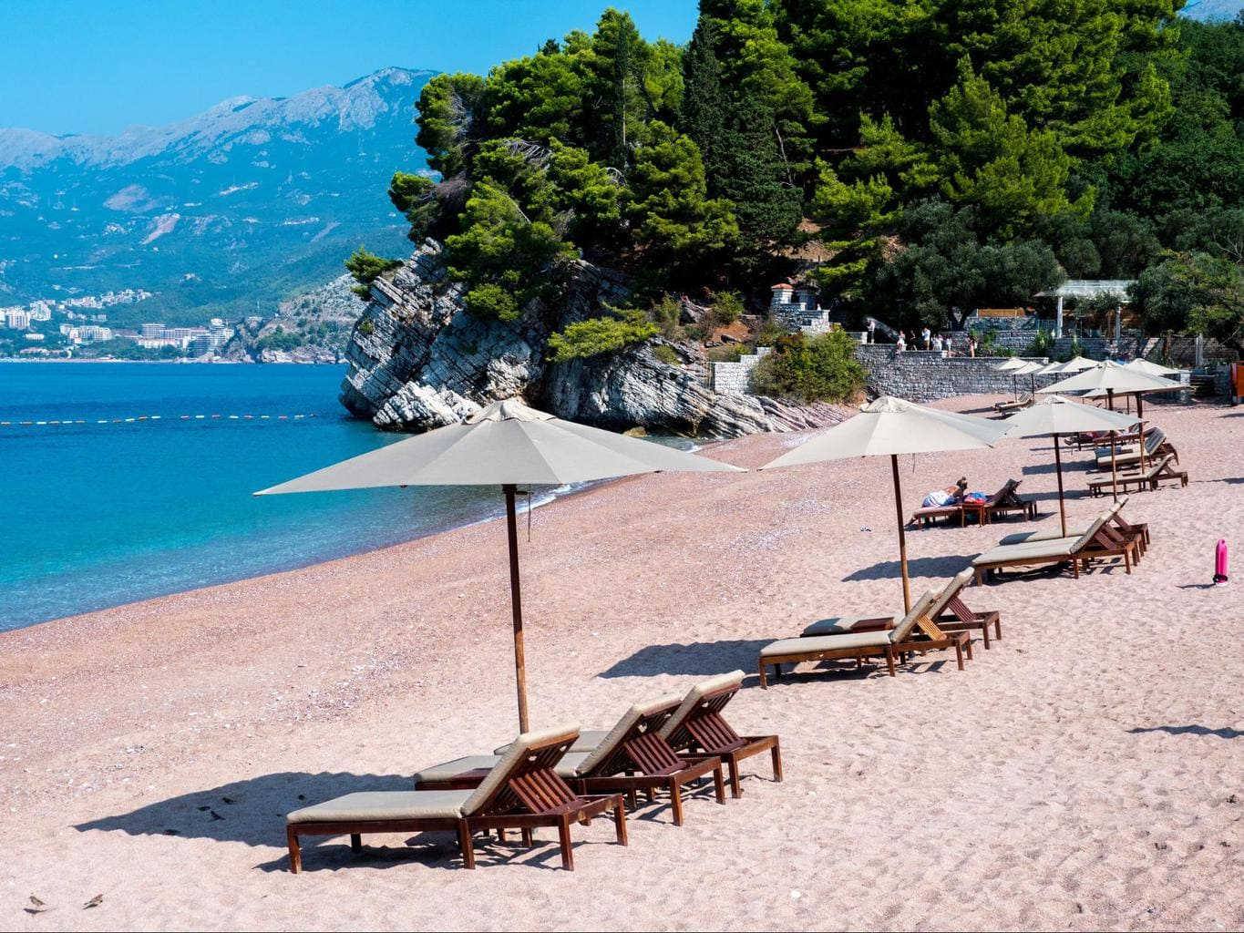Sunbeds and umbrellas fill the beaches in Montenegro