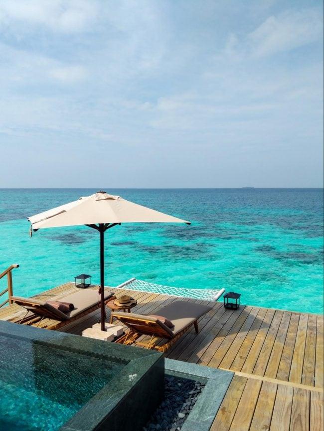 Outdoor decks at the over water villas at Joali Maldives