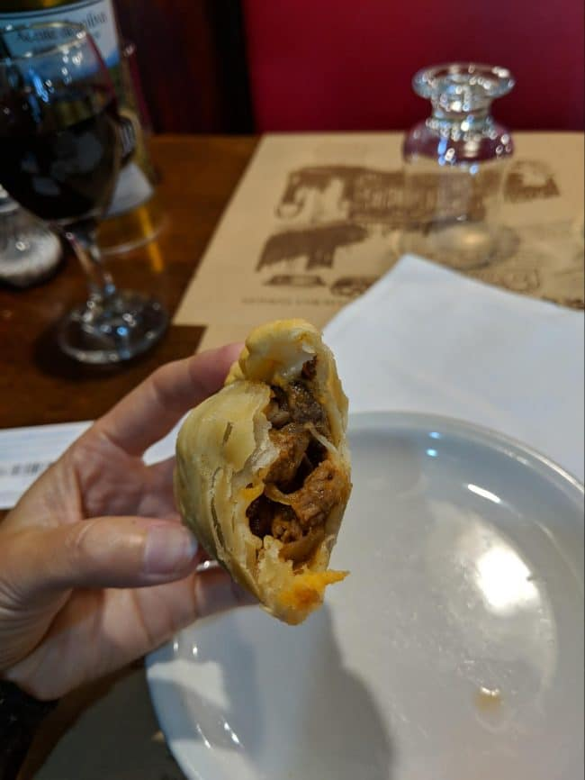 Inside an Argentinian beef, cheese and ham empanada