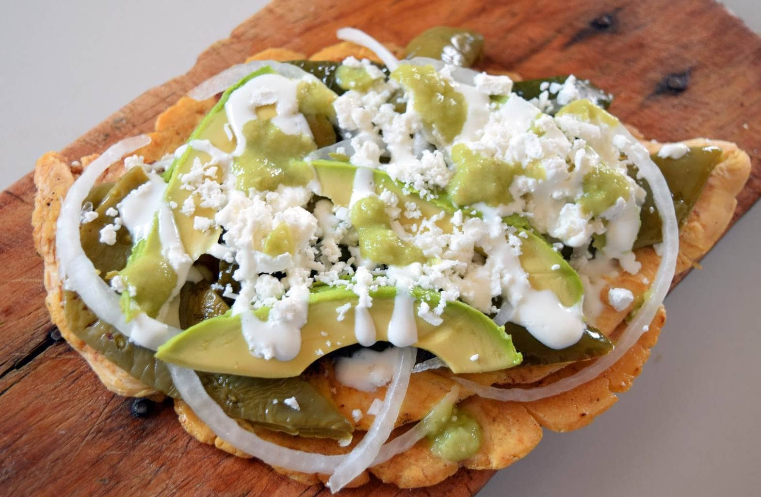 Huarache is a Mexican dish made with coarser toasted corn masa dough
