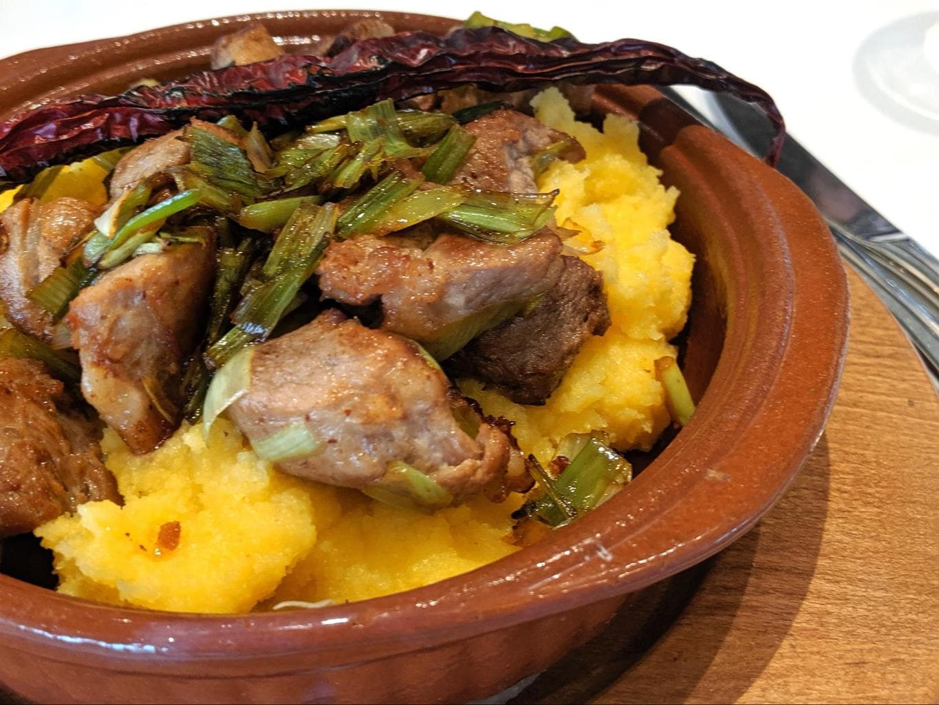 Polenta as the base for a Macedonian grilled meat dish