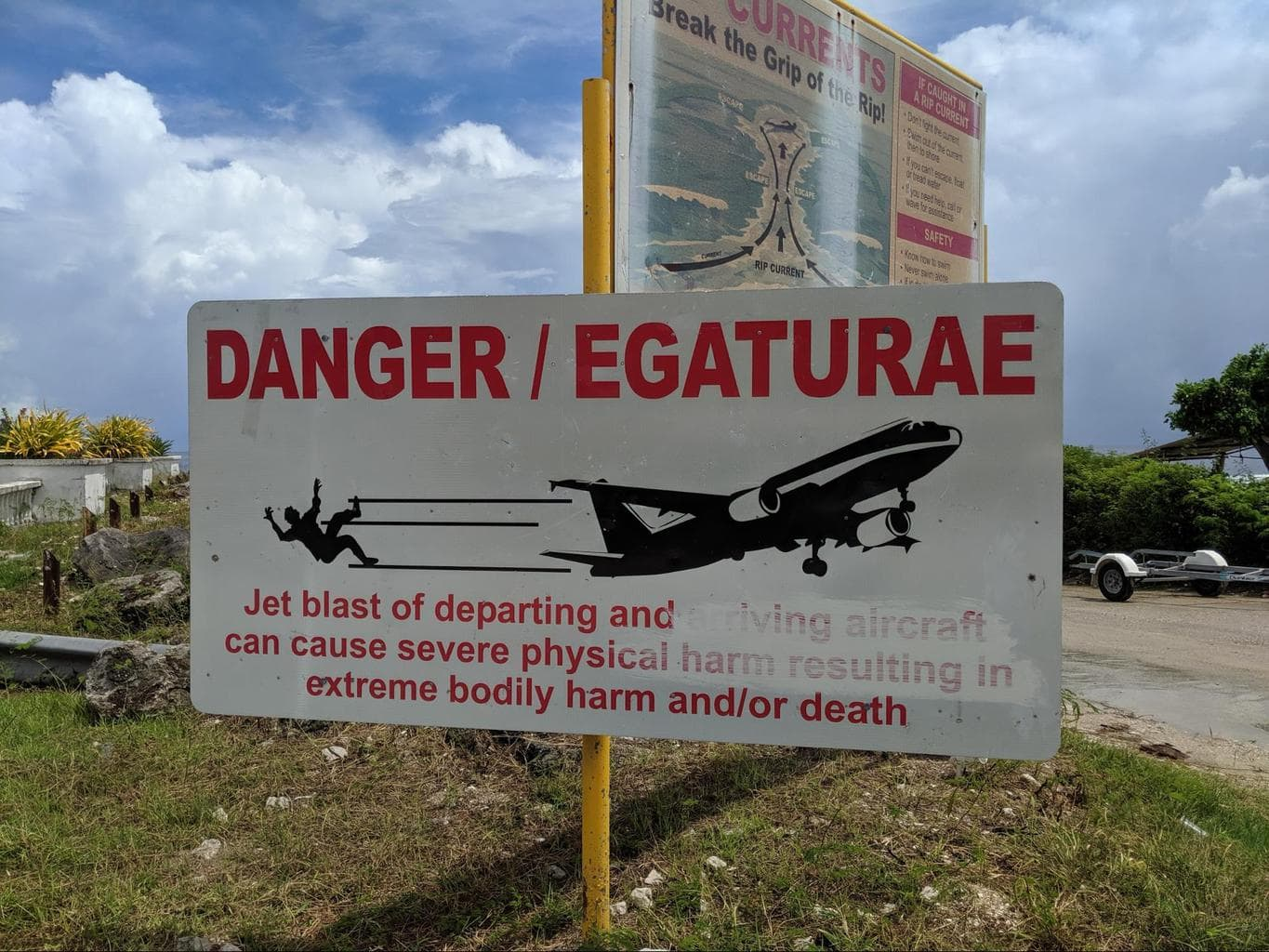 Sign by the runway reminding everyone of the dangers of jet blast