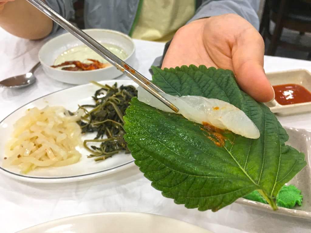 Eating Hweh sashimi