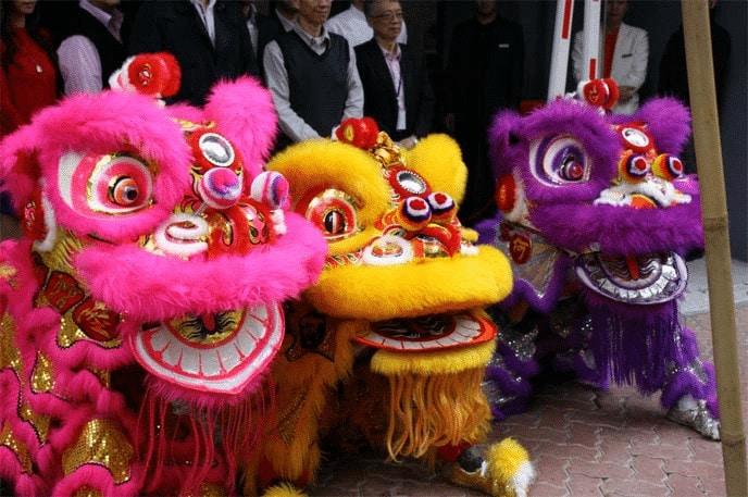 A trio of lion/dragon dancers