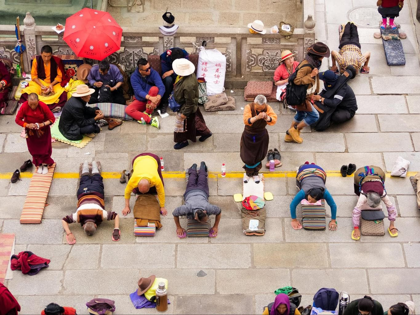 Locals prostrating in front of Jokhang Temple