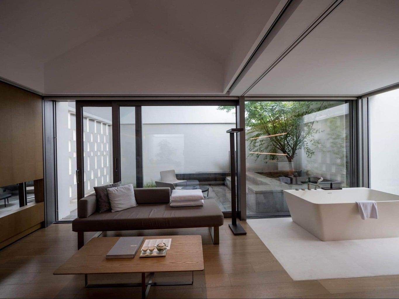 Sofa and courtyard at Alila Wuzhen