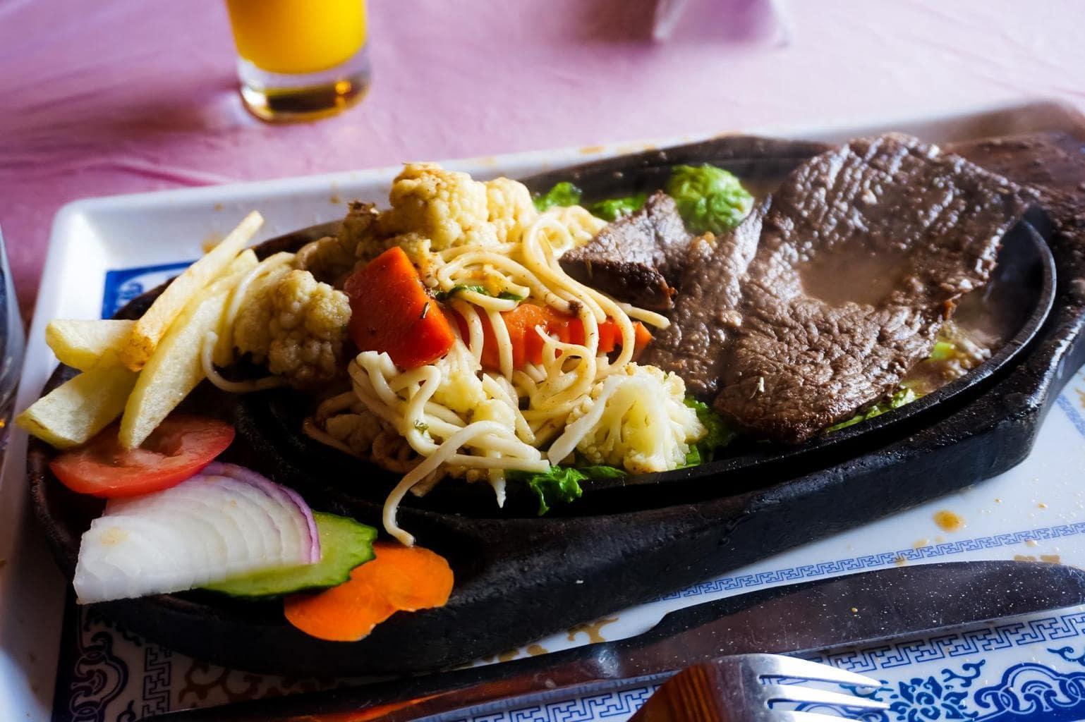 Yak steak with noodles in Tibet