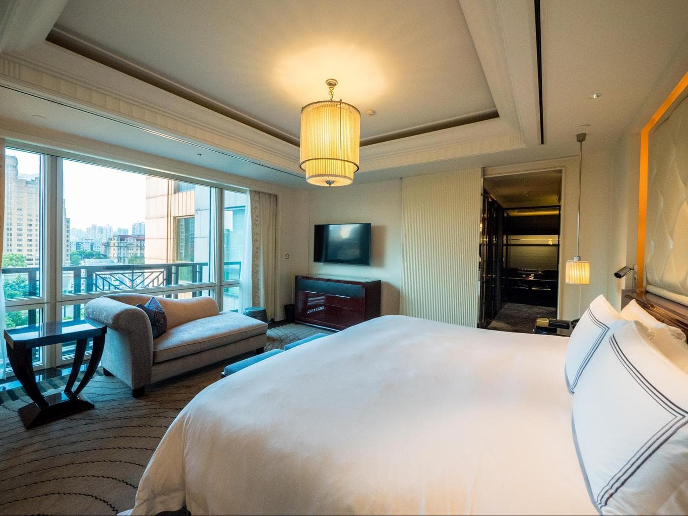 The bedroom at a Deluxe River Suite living room