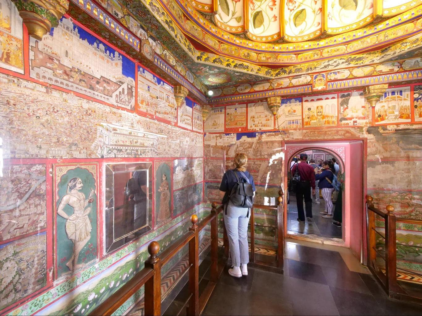 Looking miniature murals at Udaipur City Palace
