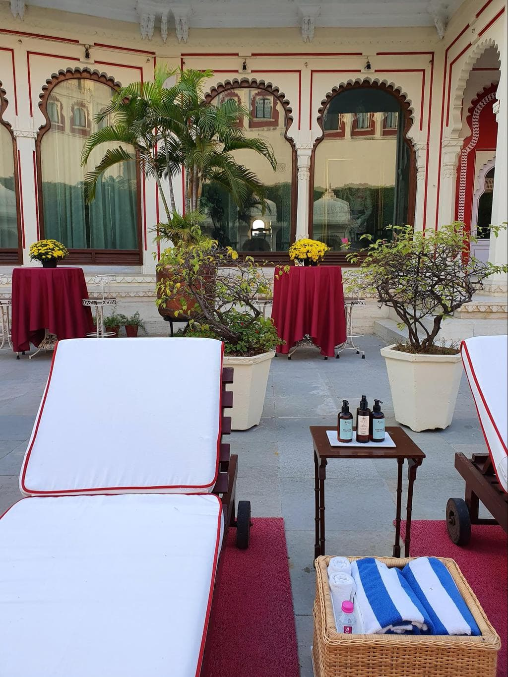 Sun loungers by the pool at Shiv Niwas Palace