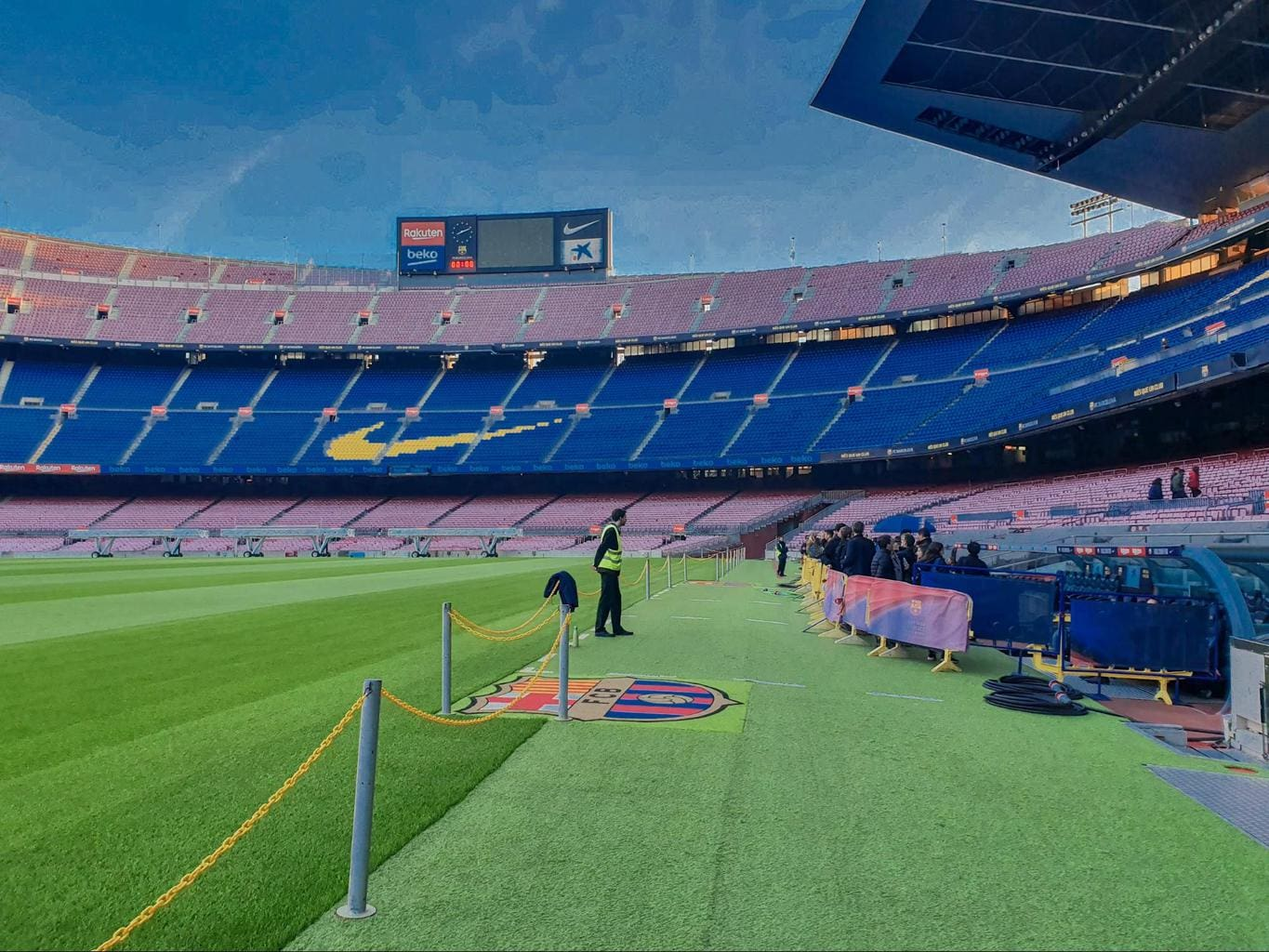 Walk and touch the grass during the Players Experience Camp Nou tour