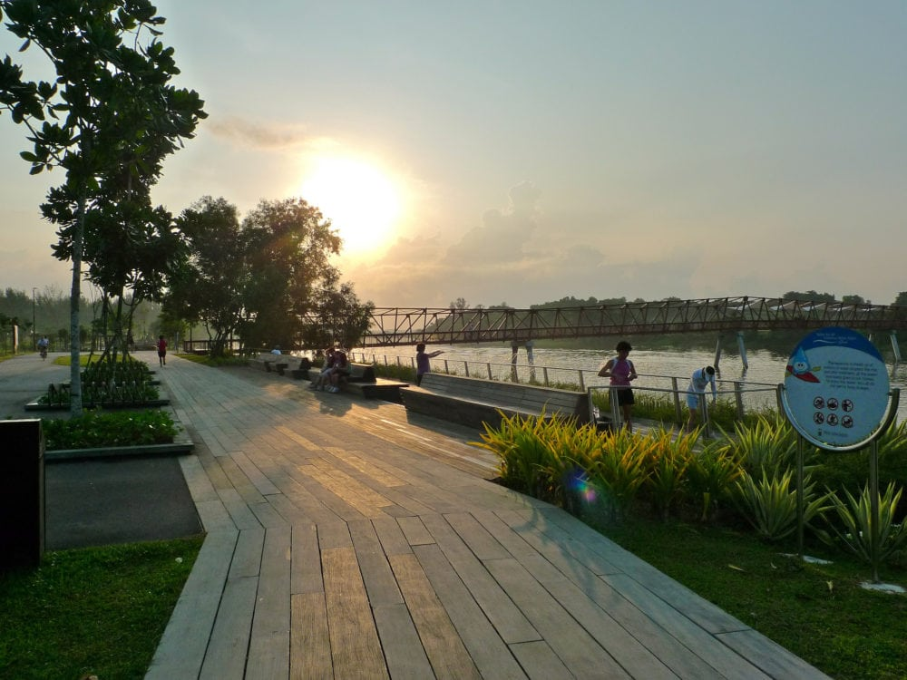 Sunrise at the Riverside Walk and the railway-like Lorong Halus Bridge in the distance