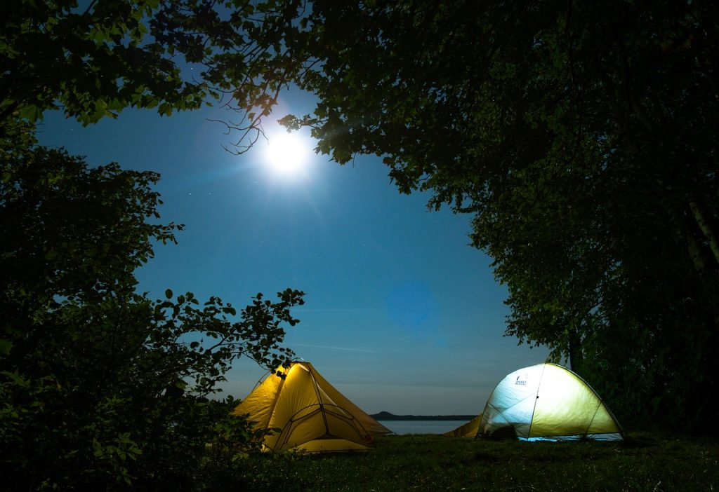 Pitching a tent at night while camping in Singapore