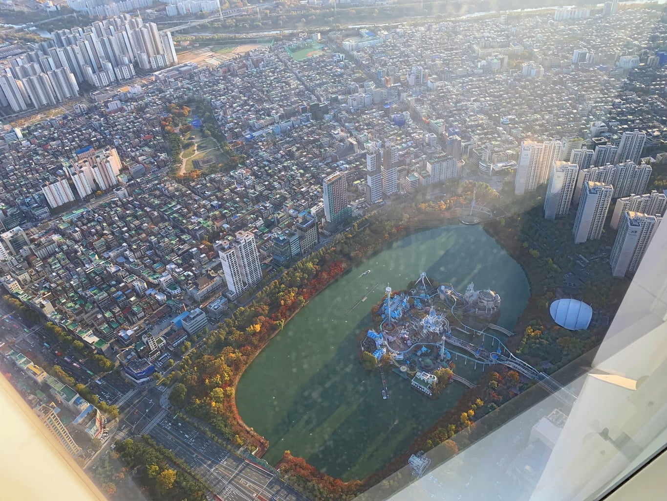 View of Lotte World from way up on the 121st floor of Lotte World Tower