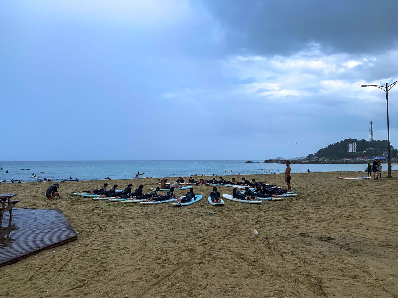 Surf class at Ingu Beach on a stormy Summer day