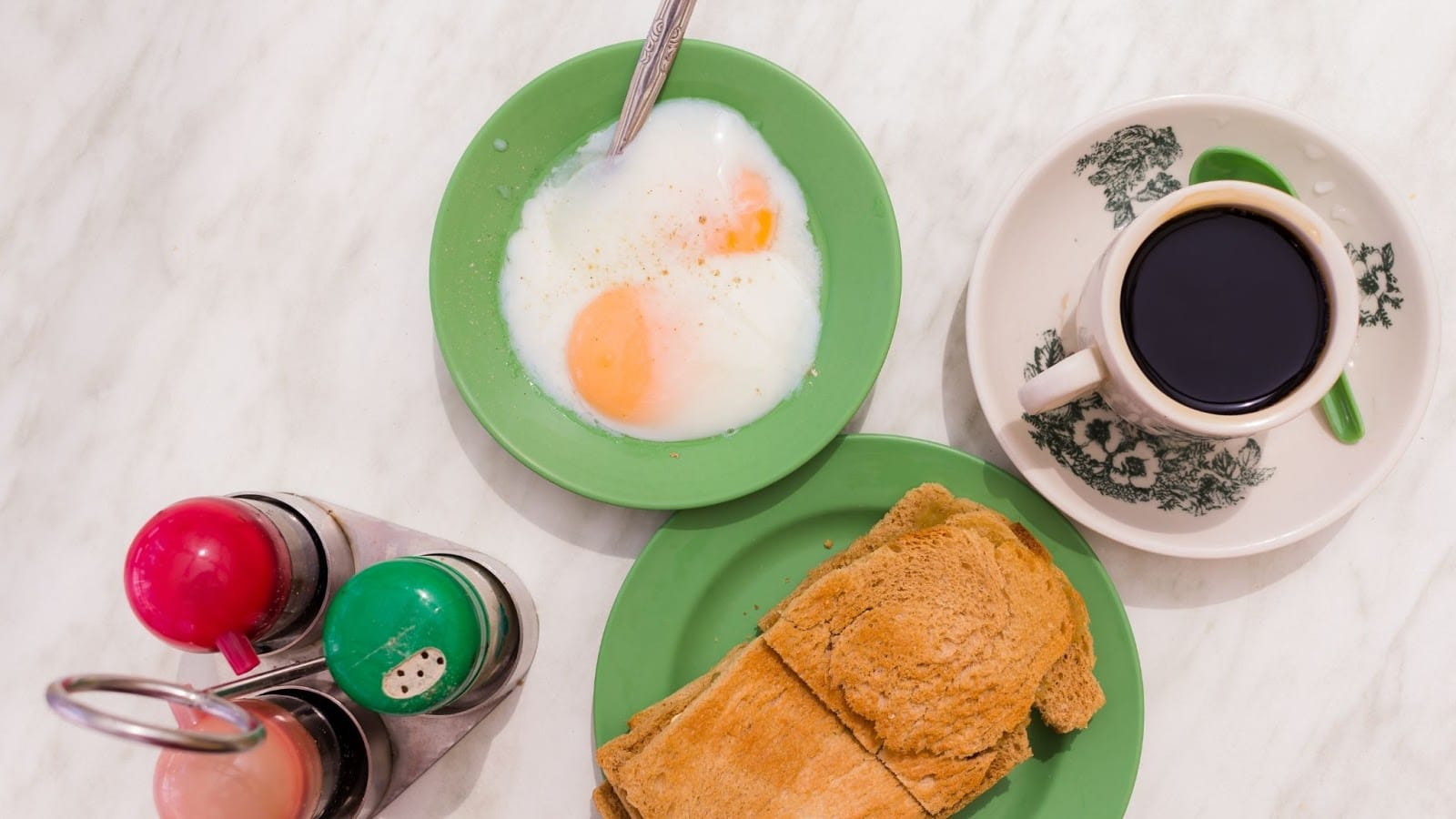 Traditional Singaporean breakfast of kopi, kaya toast and 2 runny eggs